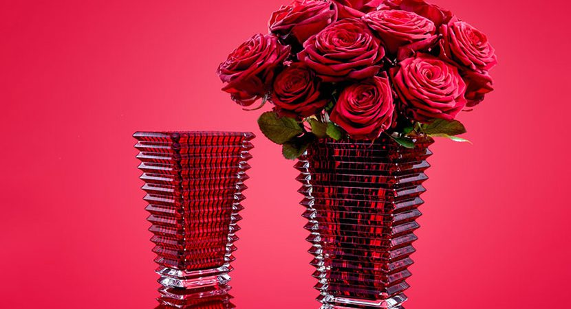 red glass vase with roses