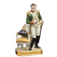 Porcelain Napoleon with Hat in Chair