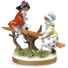Children On Seesaw Porcelain Figurine