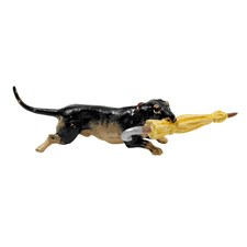 Austrian Bronze Dachshund Running with Umbrella